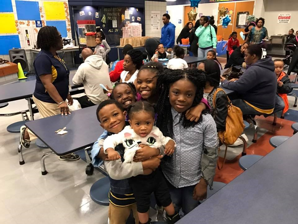 Students hugging and smiling for a picture