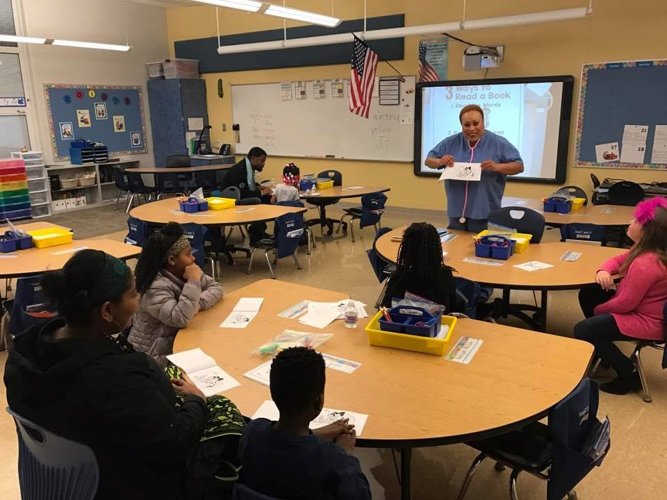 Students learning an elementary classroom
