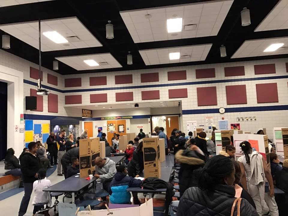 Families gathered in the cafeteria