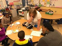 Mrs. M helping a student and parent