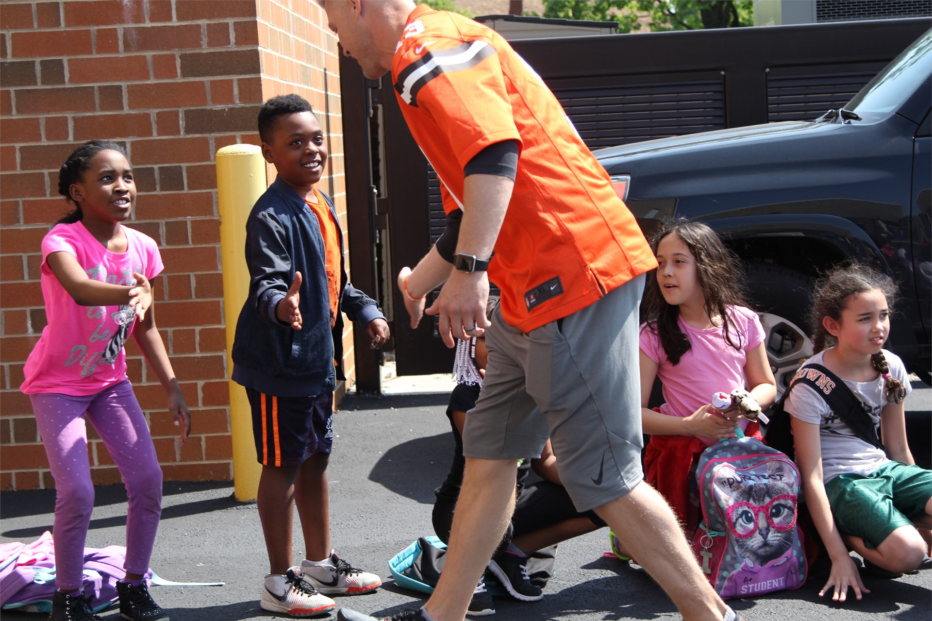Arbor students getting high-fives from Cleveland Browns player