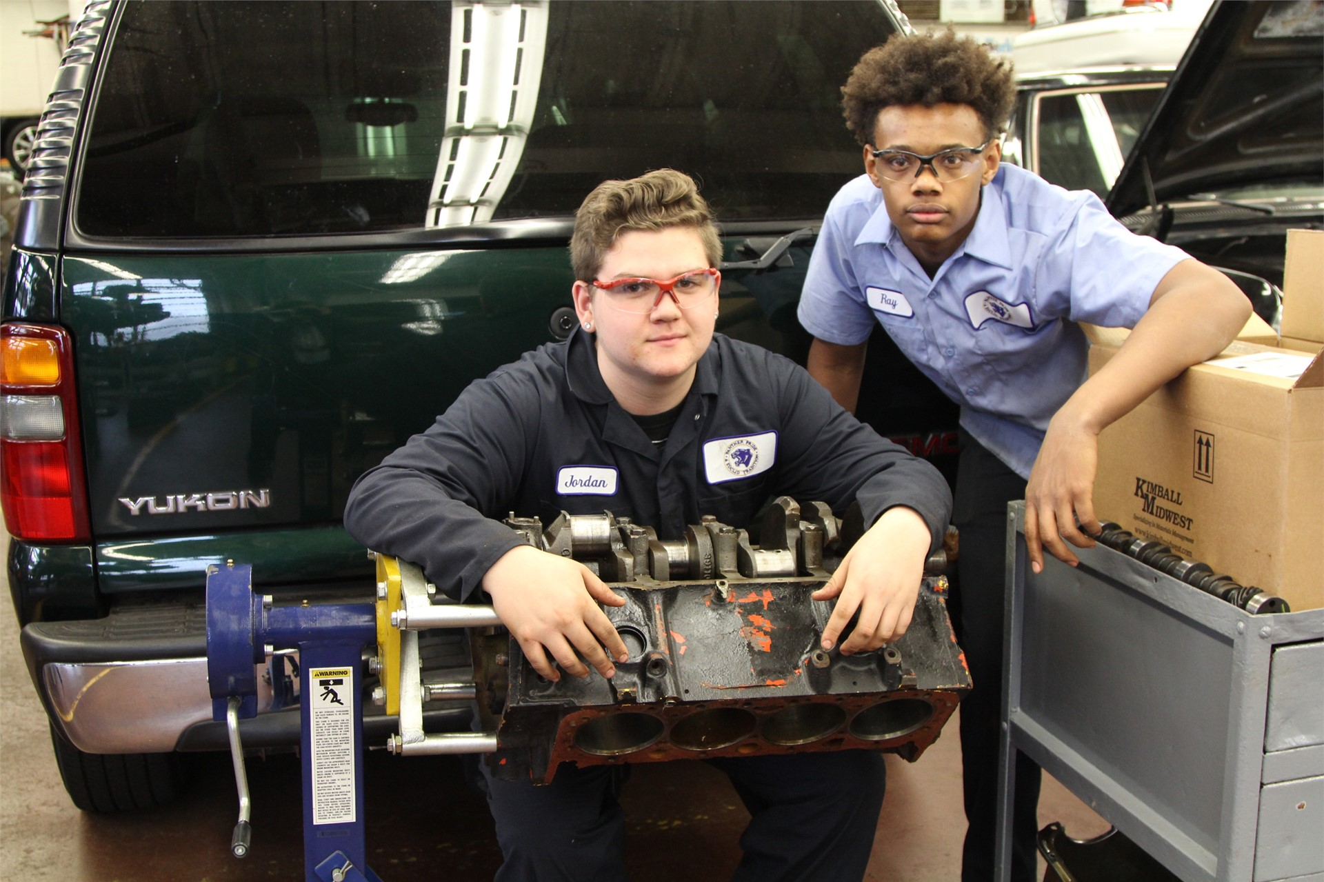 Auto Shop students working with a motor