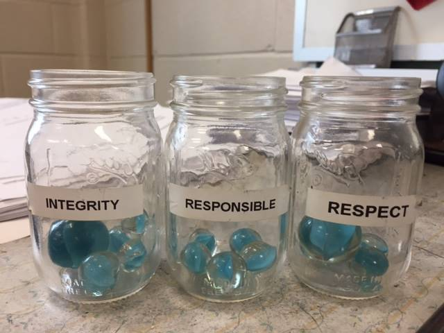 Mason jars of respect, responsibility and integrity