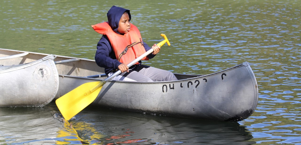 Central sixth grader canoeing at Camp Hiram