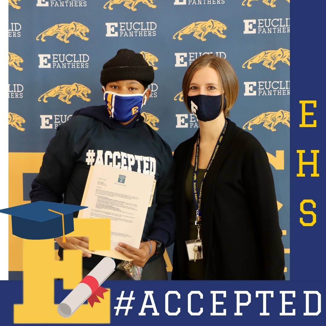 senior student holding college acceptance letter with HS Councilor