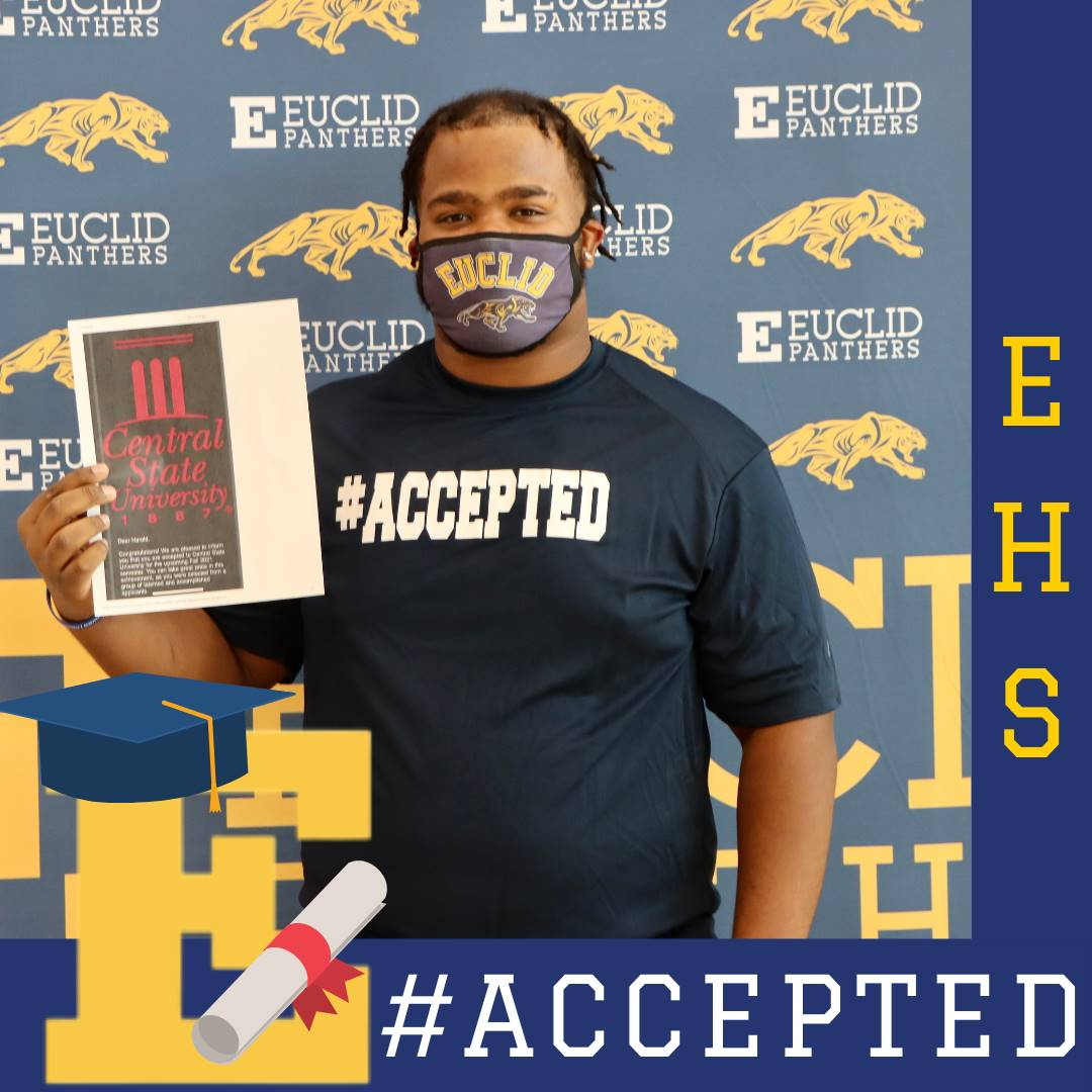senior student holding college acceptance letter
