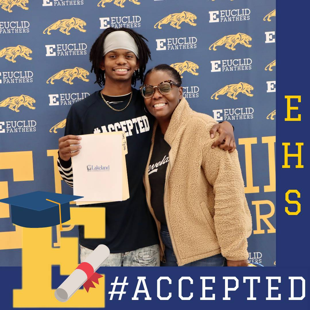 senior student holding college acceptance letter with mother