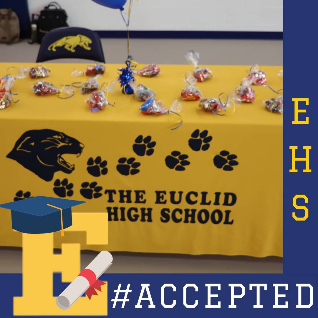 Gold Euclid High School Table cloth with bags of candy on top